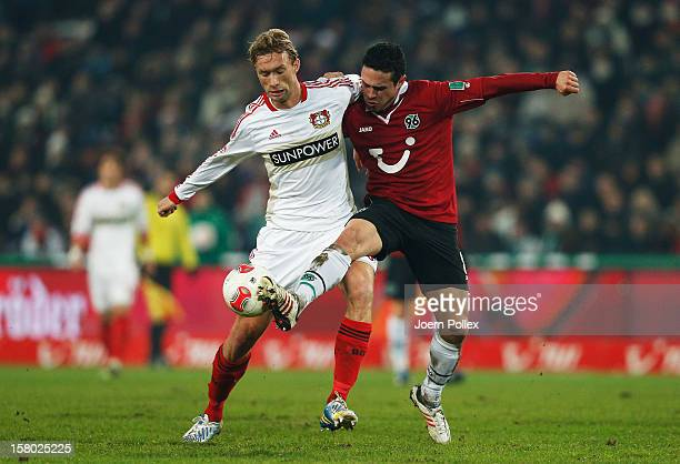 Manuel Schmiedebach of Hannover and Simon Rolfes of Leverkusen compete for the ball during the Bundesliga match between Hannover 96 and Bayer 04...