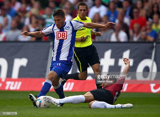 Manuel Schmiedebach of Hannover and Tunay Torun of Berlin battle for the ball during the Bundesliga match between Hannover 96 and Hertha BSC Berlin...