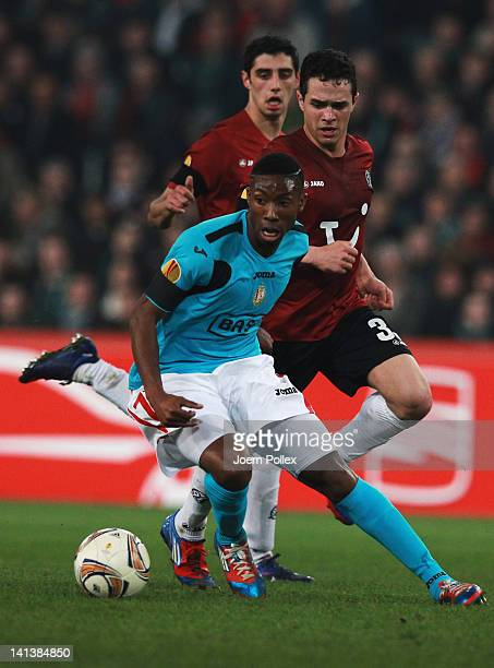 Manuel Schmiedebach of Hannover and Yoni Buyens of Liege battle for the ball during the UEFA Europa League second leg round of 16 match between...