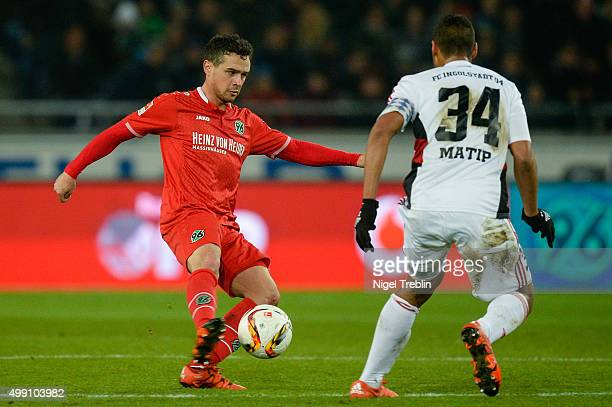 Manuel Schmiedebach of Hannover is challenged by Marvin Matip of Ingolstadt during the Bundesliga match between Hannover 96 and FC Ingolstadt at HDI...
