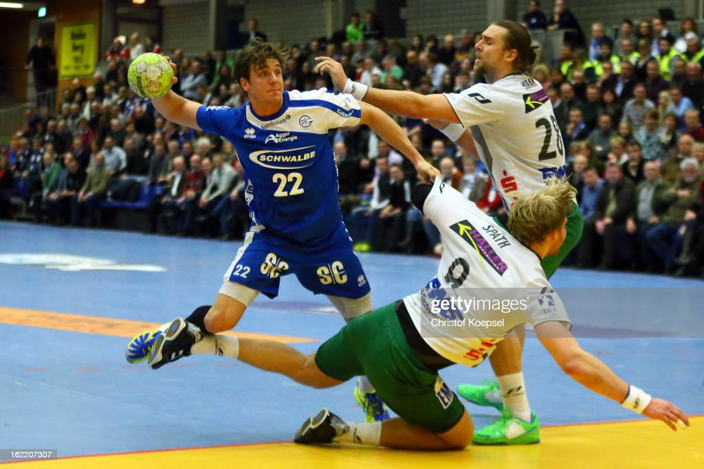 Manuel Spaeth (C) and Pavel Horak of Goeppingen (R) defend against Kentin Mahe of Gummersbach (L) during the DKB Handball Bundesliga match between VfL Gummersbach and FrischAuf Goeppingen at Eugen-Haas-Sporthalle on February 20, 2013 in Gummersbach, Germany.