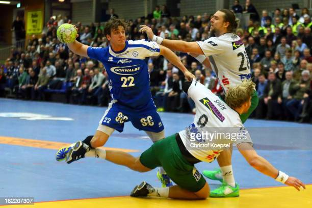 Manuel Spaeth and Pavel Horak of Goeppingen defend against Kentin Mahe of Gummersbach during the DKB Handball Bundesliga match between VfL...