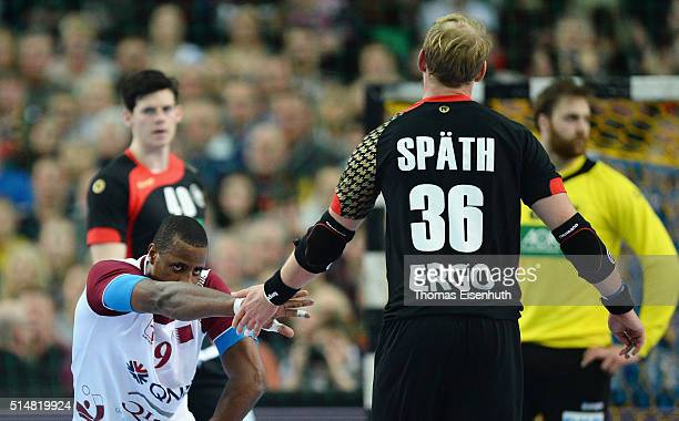 Manuel Spaeth of Germany shakes the hand with Rafael Capote of Qatar during a international friendly handball match between Germany and Qatar on...