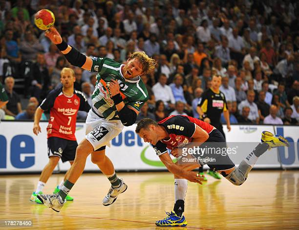 Manuel Spaeth of Goeppingen throws a goal during th DKB Bundesliga game between SG Flensburg Handewitt and Frisch Auf Goeppingen at the Flens arena...