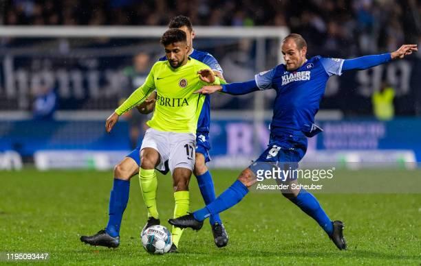 Manuel Stiefler of Karlsruhe in action against Daniel-Kofi Kyereh of Wiesbaden during the Second Bundesliga match between Karlsruher SC and SV Wehen...