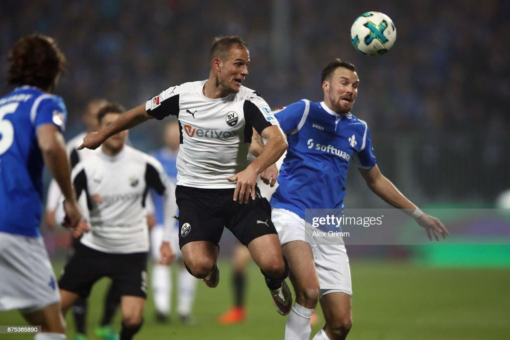 Manuel Stiefler of Sandhausen is challenged by Kevin Grosskreutz of Darmstadt during the Second Bundesliga match between SV Darmstadt 98 and SV Sandhausen at Jonathan-Heimes-Stadion am Boellenfalltor on November 17, 2017 in Darmstadt, Germany.
