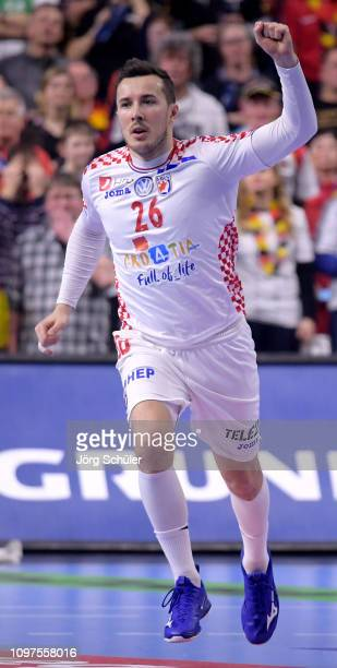 Manuel Strelek of Croatia celebrates during the 26th IHF Men's World Championship group 1 match between Croatia and Germany at Lanxess Arena on...