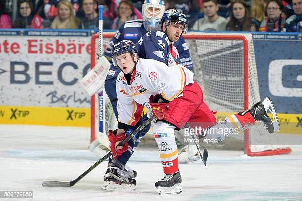 Manuel Strodel of the Duesseldorfer EG and Jens Baxmann of the Eisbaeren Berlin during the DEL game between the Eisbaeren Berlin and Duesseldorfer EG...