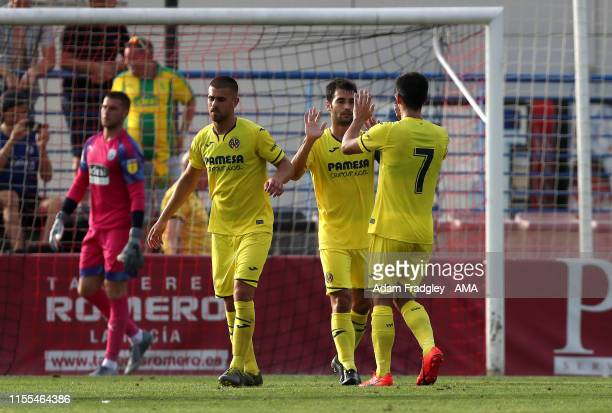 Manuel Trigueros of Villarreal CF celebrates after scoring a goal to make it 20 from the penalty spot with Gerard Moreno of Villarreal CF during a...