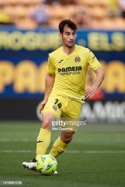 Manuel Trigueros of Villarreal CF runs with the ball during the La Liga Santander match between Villarreal CF and Sevilla FC at Estadio de la...