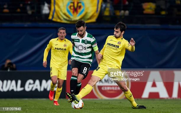 Manuel Trigueros of Villarreal competes for the ball with Bruno Fernandes of Sporting CP during the UEFA Europa League Round of 32 Second Leg match...