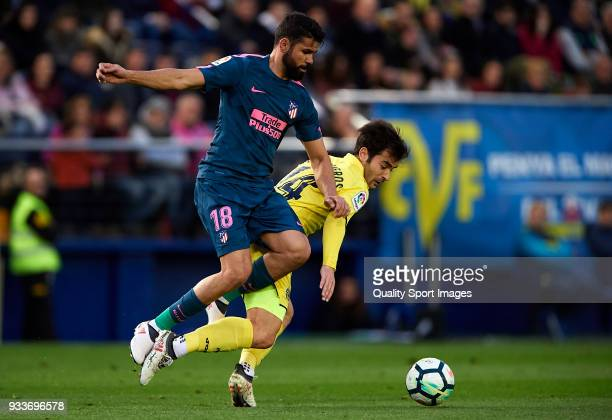 Manuel Trigueros of Villarreal competes for the ball with Diego Costa of Atletico de Madrid during the La Liga match between Villarreal and Atletico...