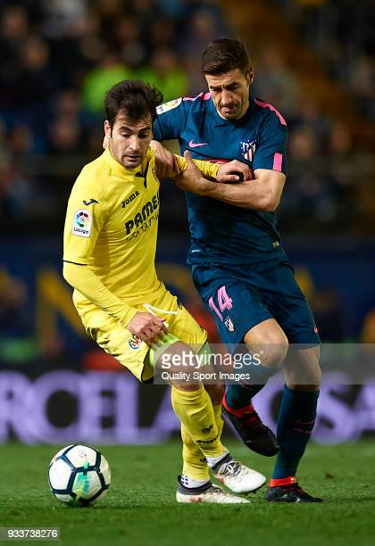 Manuel Trigueros of Villarreal competes for the ball with Gabi of Atletico de Madrid during the La Liga match between Villarreal and Atletico Madrid...