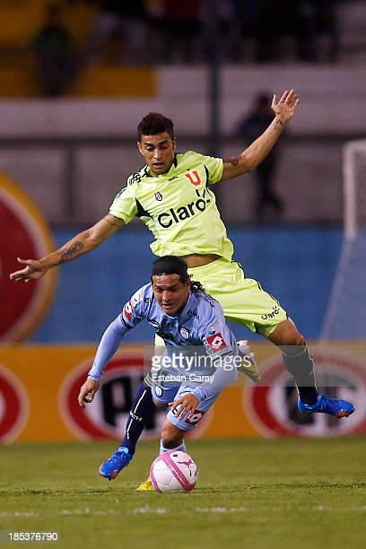 Manuel Villalobos of Deportes Iquique struggles for the ball with RubeŽn Farfa‡n of Universidad de Chile during a match between Deportes Iquique and...