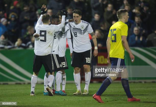 Manuel Wintzheimer Alfons Amade Linton Maina and Adrian Fein of Germany celebrate after the second goal during the Under 19 Euro Qualifier between...