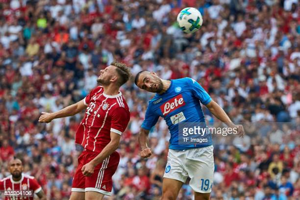 Manuel Wintzheimer of Bayern Muenchen and Nikola Maksimovic of Napoli battle for the ball during the Audi Cup 2017 match between SSC Napoli and FC...