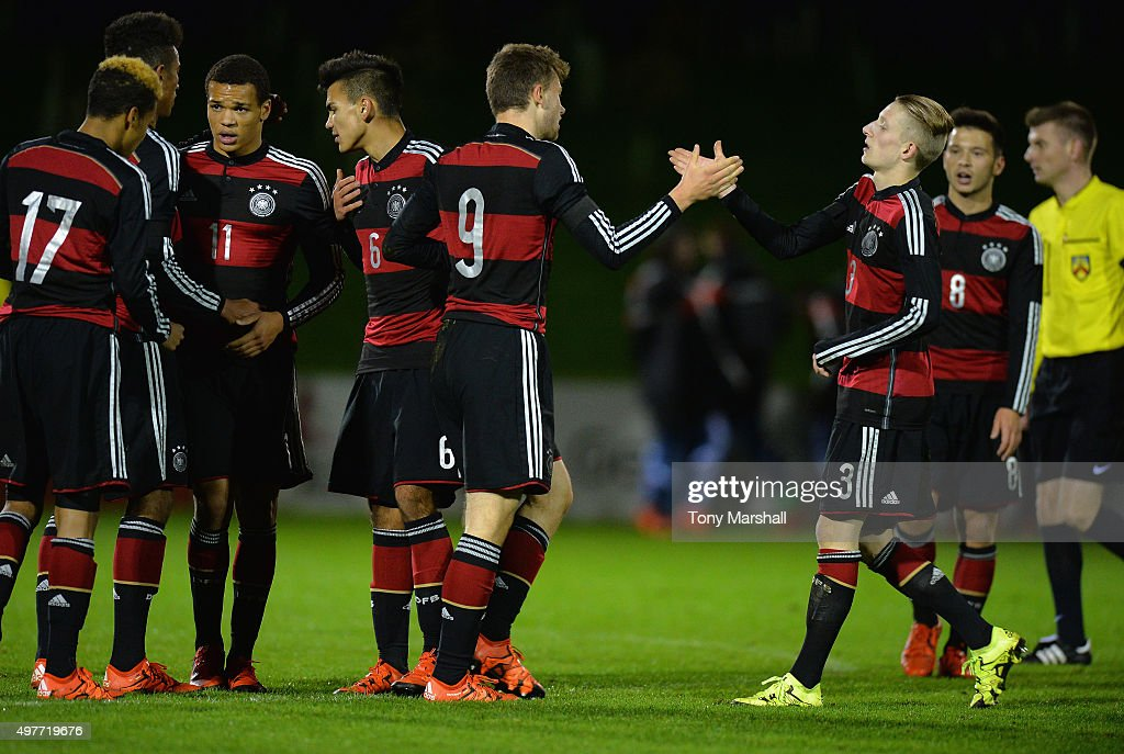Manuel Wintzheimer of Germany celebrates scoring their fifth goal with Jan-Niklas Beste of Germany during the U17s International Friendly match between England U17 and Germany U17 at St Georges Park on November 18, 2015 in Burton-upon-Trent, England.