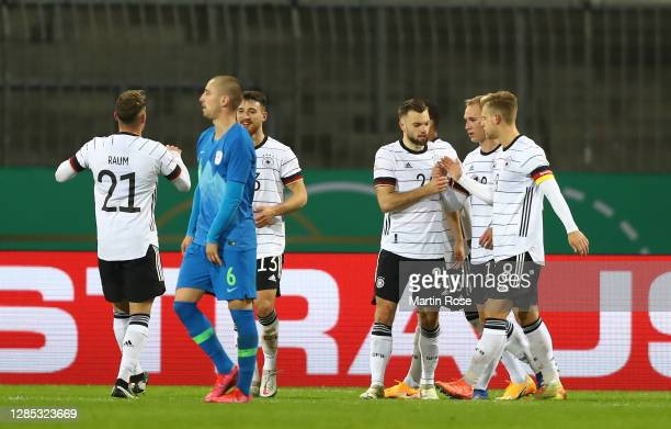 Manuel Wintzheimer of Germany celebrates with team mates after scoring his teams first goal during the international friendly match between Germany...