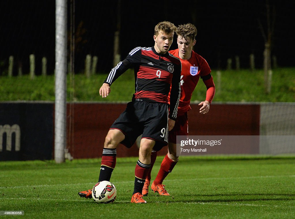 Manuel Wintzheimer of Germany shields the ball from Callum Slattery of England during the U17s International Friendly match between England U17 and Germany U17 at St Georges Park on November 18, 2015 in Burton-upon-Trent, England.