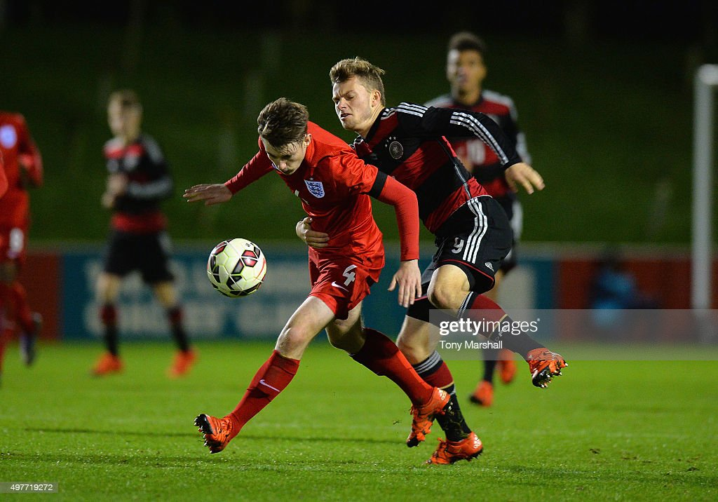 Manuel Wintzheimer of Germany tackles Callum Slattery of England during the U17s International Friendly match between England U17 and Germany U17 at St Georges Park on November 18, 2015 in Burton-upon-Trent, England.