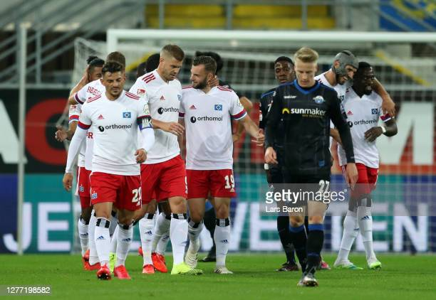 Manuel Wintzheimer of Hamburger SV celebrates with teammates after scoring his team's first goal during the Second Bundesliga match between SC...