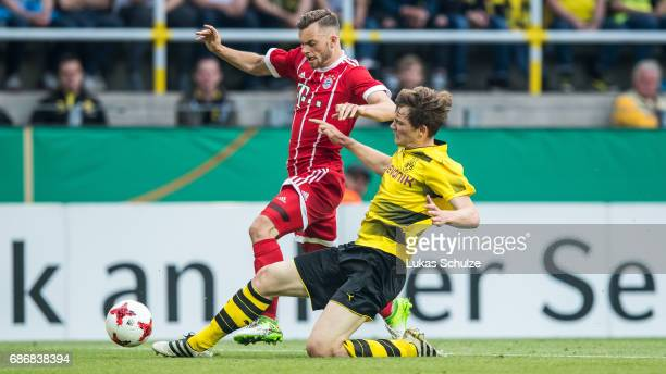 Manuel Wintzheimer of Munich and Luca Kilian of Dortmund fight for the ball during the U19 German Championship Final between Borussia Dortmund and FC...