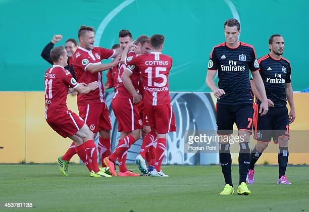 Manuel Zeitz of Energie Cottbus celebrates with his team-mates after scoring the opening goal during the DFP Cup first round match between Energie...