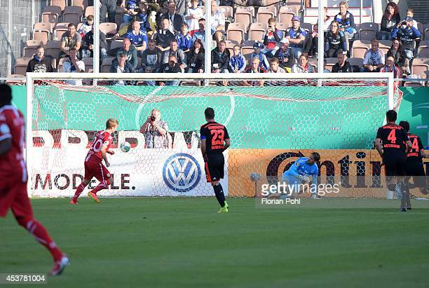 Manuel Zeitz of FC Energie Cottbus scores the opening goal during the DFP Cup first round match between Energie Cottbus and Hamburger SV at Stadion...