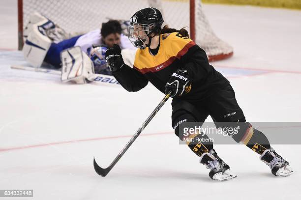 Manuela Anwander of Germany celebrates scoring the winning goal in the penalty shoot out during the Women's Ice Hockey Olympic Qualification Final...