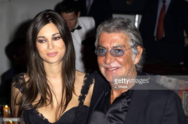 Manuela Arcuri and Robero Cavalli during 2003 Cannes Film Festival Roberto Cavalli Fashion Show Dinner at Palm Beach in Cannes France