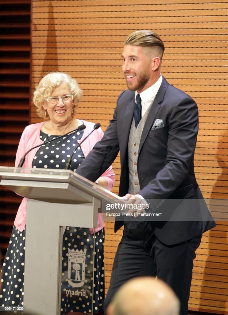 Manuela Carmena and Sergio Ramos celebrate during the Real Madrid celebration the day after winning the 12th UEFA Champions League Final at Madrid town hall on June 4, 2017 in Madrid, Spain.