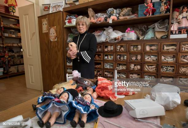 Manuela Cutileira owner of 'Hospital de Bonecas' checks on broken dolls at the hospital on January 18 2018 in Lisbon Portugal Started in 1830 by Dona...