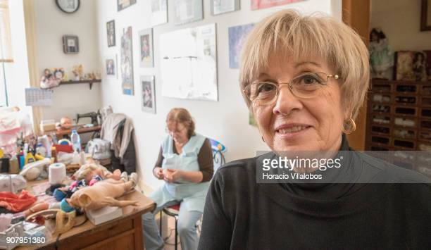 Manuela Cutileira owner of 'Hospital de Bonecas' is seen with Ermelinda Francisco who is at work on one of the dolls at 'Hospital de Bonecas' on...