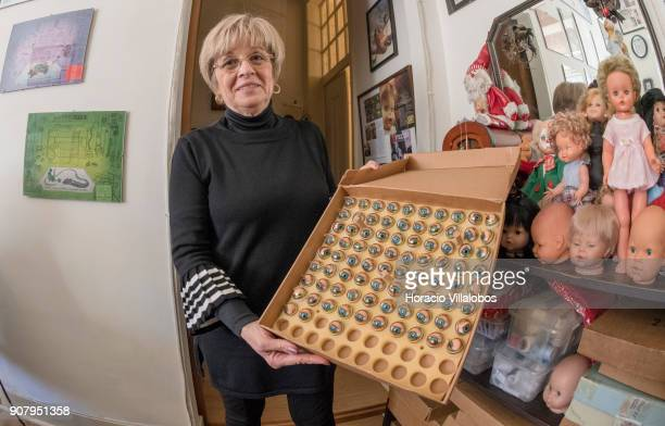 Manuela Cutileira owner of 'Hospital de Bonecas' shows sets of eyes to be used in dolls on January 18 2018 in Lisbon Portugal Started in 1830 by Dona...