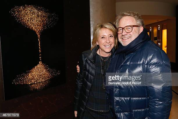 Manuela Isnard Seznec and Dominique Segall attend the Arthur Aubert Exhibition private view Held at Le Fouquet's Barriere Hotel on February 6 2014 in...