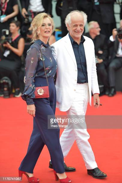 """Manuela Lamanna and Toni Servillo walk the red carpet ahead of the Opening Ceremony and the """"La Vérité"""" screening during the 76th Venice Film..."""
