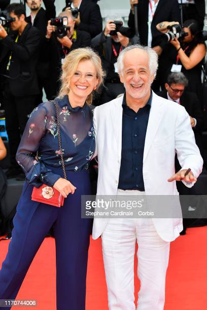 Manuela Lamanna and Toni Servillo walk the red carpet ahead of the opening ceremony during the 76th Venice Film Festival at Sala Casino on August 28,...