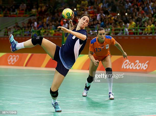 Manuela Pizzo of Argentina scores as Yvette Broch of Netherlands defends on Day 3 of the Rio 2016 Olympic Games at the Future Arena on August 8 2016...