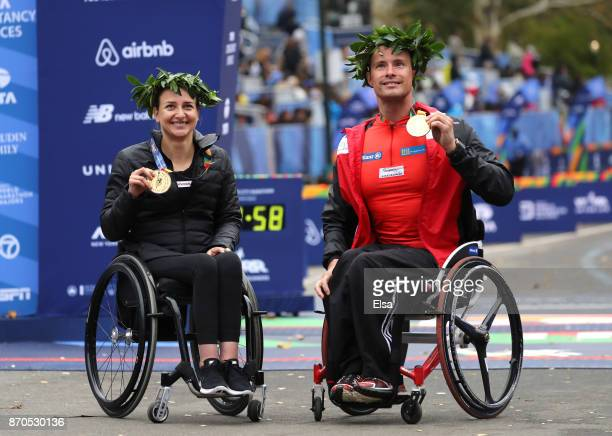 Manuela Schar of Switzerland and Marcel Hug of Switzerland celebrate winning the Professional Wheelchair Divisions during the 2017 TCS New York City...