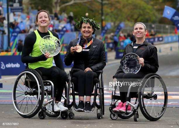 Manuela Schar of Switzerland celebrates winning the Professional Women's Wheelchair Division with Tatyana McFadden of the United States and Amanda...