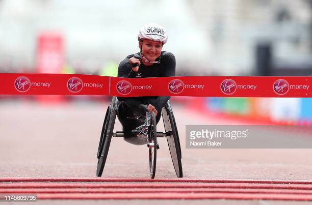 Manuela Schar of Switzerland crosses the line to win the Women's Elite Wheelchair race during the 2019 Virgin Money London Marathon in the United...