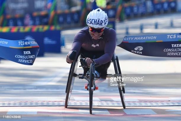 Manuela Schar of Switzerland reacts as she crosses the finish line to win the Women's Wheelchair Division of the 2019 TCS New York City Marathon on...