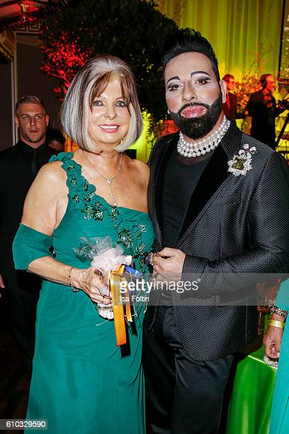 Manuela Schmid and fashion designer Harald Gloeoeckler attend the7th VITA Charity Gala in Wiesbaden on September 24 2016 in Wiesbaden Germany