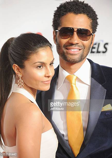 Manuela Testolini and singer Eric Benet arrive at the 2009 MusiCares Person of the Year Tribute to Neil Diamond at the Los Angeles Convention Center...