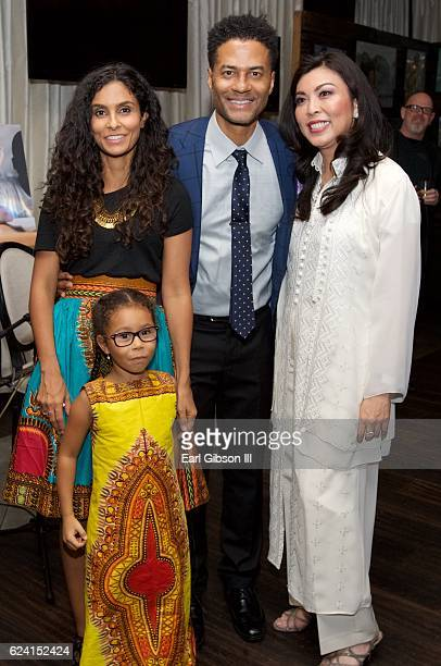 Manuela Testolini Eric Benet guest and Lucia Bella Benet attend the 'In A Perfect World Give 100 Fundraiser' at The District Restaurant on November...