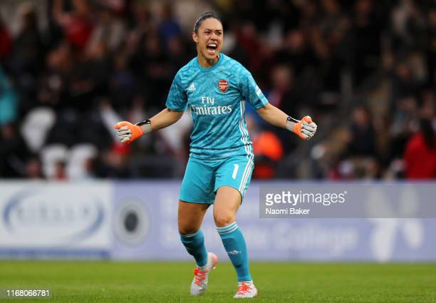 Manuela Zinsberger of Arsenal celebrates her sides first goal during the Pre Season Friendly match between Arsenal and Barcelona at Meadow Park on...