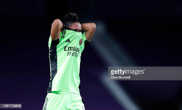 Manuela Zinsberger of Arsenal looks dejected following her team's defeat in the UEFA Women's Champions League Quarter Final between Arsenal FC Women...