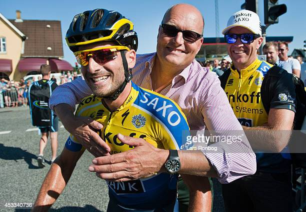 Manuele Boaro of Tinkoff Saxo celebrates with team manager Bjarne Riis winning stage three of the Tour of Denmark between Skanderborg and Vejle on...