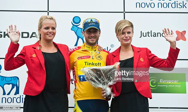 Manuele Boaro of Tinkoff Saxo on the podium in the leaders yellow jersey after stage four of the Tour of Denmark between Nyborg and Odense on August...