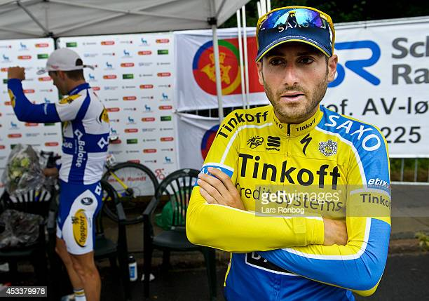 Manuele Boaro of Tinkoff Saxo waits to go on the podium to receive the leaders yellow jersey after stage four of the Tour of Denmark between Nyborg...